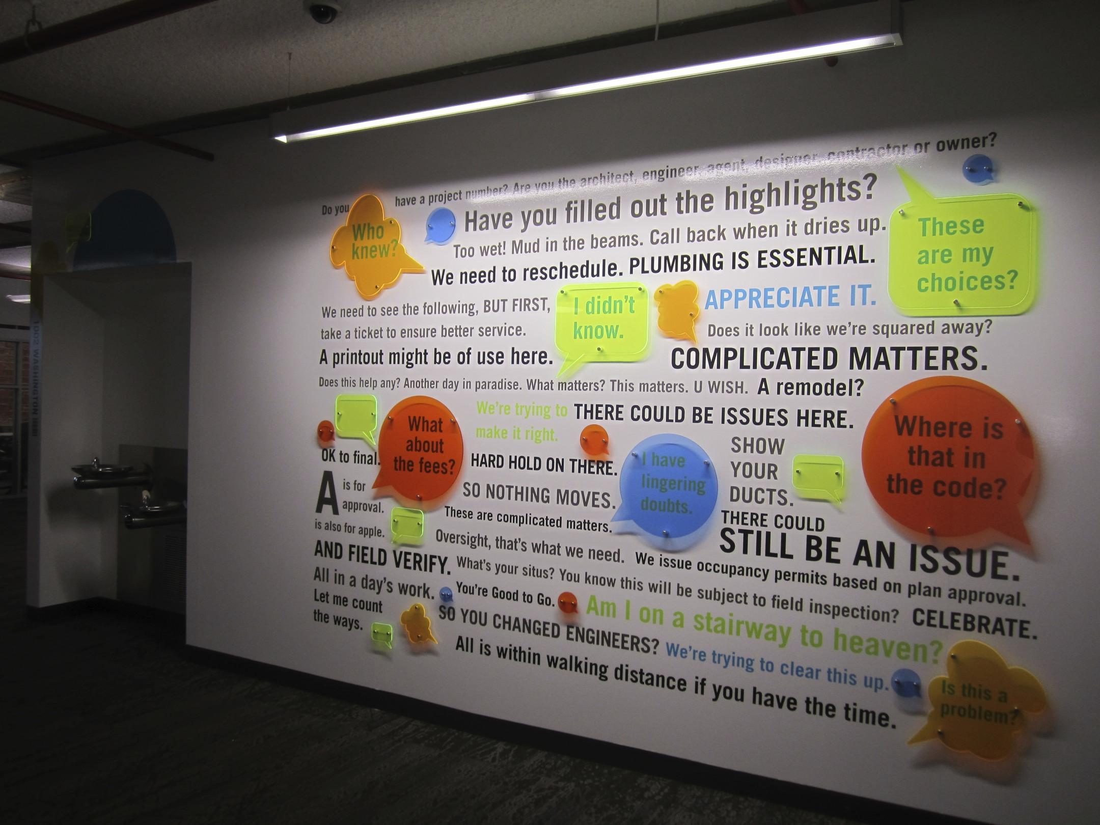 mural of words and phrases with plexiglass